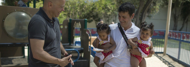 Jason Howe, 48, and Adrian Perez, 48, who were married in Spain, and again in California, look at their twin daughters Clara (2nd L) and Olivia at a playground in West Hollywood, California after the United States Supreme Court ruled on California's Proposition 8 and the federal Defense of Marriage Act, June 26, 2013. The U.S. Supreme Court delivered a landmark victory for gay rights on Wednesday by forcing the federal government to recognize same-sex marriages in states where it is legal and paving the way for it in California, the most populous state. REUTERS/Lucy Nicholson (UNITED STATES - Tags: SOCIETY POLITICS) - RTX112E6