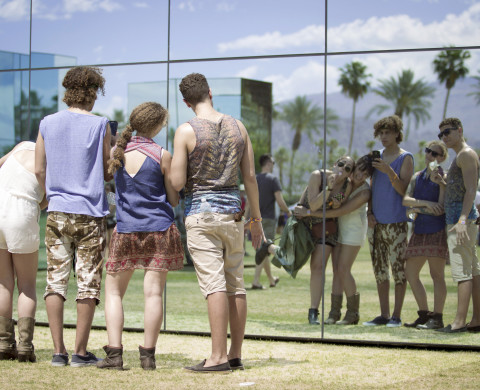 INDIO, CA - APRIL 11:  Music fans seen during day 1 of the 2014 Coachella Valley Music & Arts Festival at the Empire Polo Club on April 11, 2014 in Indio, California. (Photo by Chelsea Guglielmino/Getty Images for Coachella)