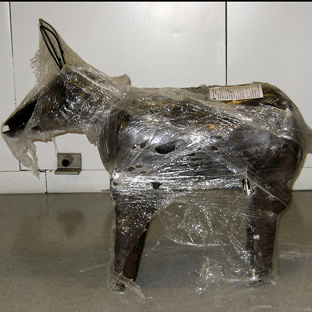 One of 200 cement yard statues shaped like a donkey is shown on display in this handout image provided by the U.S. Immigration and Customs Enforcement agency and released to Reuters February 4, 2009. Law enforcement agents seized 1800 pounds of marijuana valued at $1.5 million that had been hidden in the 200 statues in the cities of Fontana, California and Sun Valley, California.  REUTERS/U.S. Immigration and Customs Enforcement/Handout   (UNITED STATES).  FOR EDITORIAL USE ONLY. NOT FOR SALE FOR MARKETING OR ADVERTISING CAMPAIGNS. - RTXB9YW