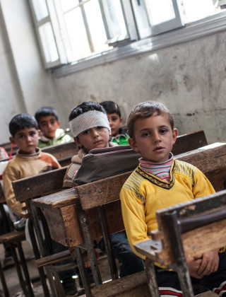 Blackboards Over Bullets: How One Ravaged Syrian Town Reopened Its School