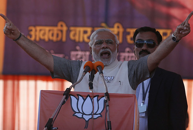 Hindu nationalist Narendra Modi, prime ministerial candidate for the main opposition Bharatiya Janata Party (BJP), gestures as he address a rally in Gurgaon on the outskirts of New Delhi April 3, 2014.