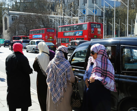 A group of female Arab tourists seen here in Parliament Square. -- Images of some of the colourful characters in the UK's cosmopolitan capital, taken over a period of two days in April.