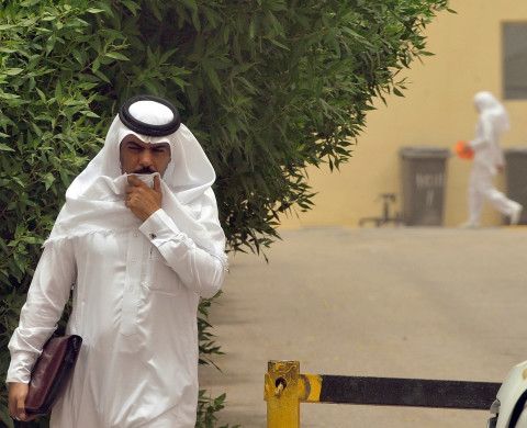 A Saudi man walks towards the King Fahad hospital in the city of Hofuf, 370 kms East of the Saudi capital Riyadh, on June 16, 2013. Four people have died from the MERS virus in Saudi Arabia, bringing the death toll from the SARS-like virus in the kingdom to 32, the health ministry said. The World Health Organisation announced that the global death toll from MERS had reached 33, with 28 of them in the kingdom. The virus is a member of the coronavirus family, which includes the pathogen that causes Severe Acute Respiratory Syndrome (SARS). AFP PHOTO/FAYEZ NURELDINE        (Photo credit should read FAYEZ NURELDINE/AFP/Getty Images)