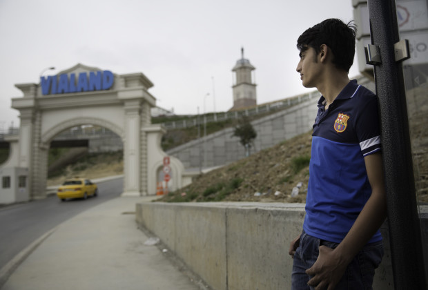 A boy waits for the Vialand shuttle bus. Vialand is Turkey's new 'Disneyland' attraction. PHOTO BY JODI HILTON FOR VOCATIV