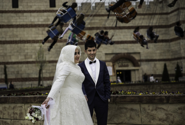 "Ebru, l, and Muharrem Yildirim decided to have their wedding photos taken at Vialand. ""It's a fun place,"" said Muharrem. Vialand is Turkey's new 'Disneyland' attraction. PHOTO BY JODI HILTON FOR VOCATIV"