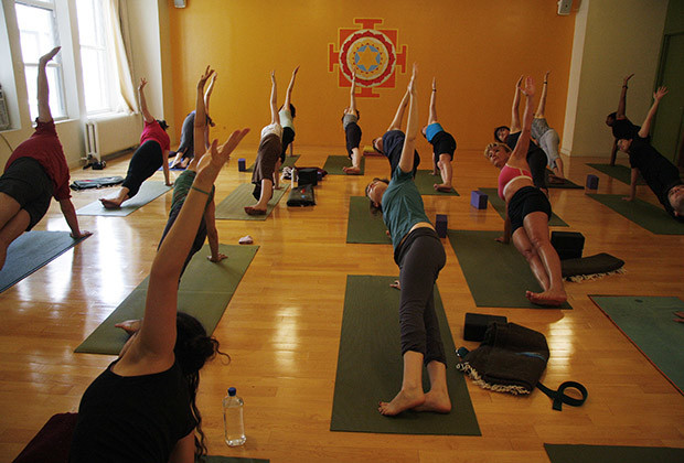 "Yoga students hold a pose during an afternoon class at ""Om Factory"" yoga studio in New York."
