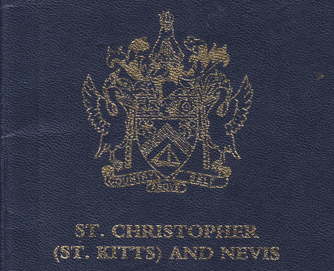 The cover of a St. Kitts and Nevis passport is seen at the main immigration office in Basseterre January 31, 2012. St. Kitts and Nevis is one of at least two countries offering so-called citizenship by investment, burgeoning programs that bestow on foreigners the benefits of being a citizen - namely, a passport for a price. Picture taken January 31.  To match Special Report PASSPORT/      REUTERS/Stanford Conway (ST. KITTS AND NEVIS - Tags: BUSINESS POLITICS SOCIETY IMMIGRATION) - RTR2XP7K