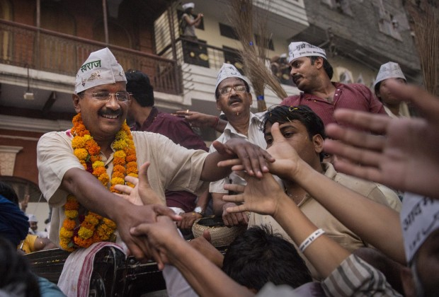 VARANASI, INDIA - MAY 09:  AAP leader Arvind Kejriwal is greeted by supporters during a rally by the leader on May 9, 2014 in Varanasi, India. India is in the midst of a nine-phase election that began on April 7 and ends May 12.  (Photo by Kevin Frayer/Getty Images)