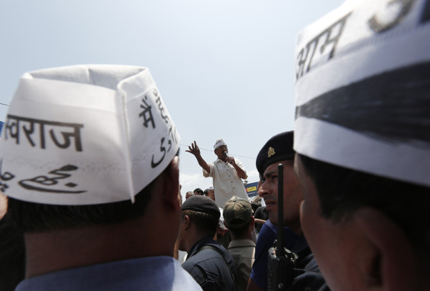 Delhi's former chief minister and Aam Aadmi (Common Man) Party (AAP) chief Arvind Kejriwal (C) addresses his supporters before filling his nomination for the general election in the northern Indian city of Varanasi April 23, 2014. Around 815 million people have registered to vote in the world's biggest election - a number exceeding the population of Europe and a world record - and results of the mammoth exercise, which concludes on May 12, are due on May 16. REUTERS/Adnan Abidi (INDIA - Tags: POLITICS ELECTIONS) - RTR3MAWS
