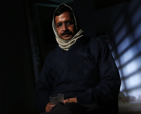 Delhi's Chief Minister Arvind Kejriwal, chief of the Aam Aadmi (Common Man) Party (AAP), poses before the start of an interview with Reuters at his residence on the outskirts of New Delhi January 27, 2014. The young anti-graft party that stormed to power in India's capital last month plans to field at least 73 candidates in national elections due by May to stand against politicians accused of crimes, its founder said on Monday. Following its strong performance in Delhi, interest in the year-old Aam Aadmi Party (AAP) has surged. Since an announcement earlier this month that it would contest the general election, its membership has passed 10 million. Picture taken January 27, 2014. REUTERS/Adnan Abidi (INDIA - Tags: POLITICS TPX IMAGES OF THE DAY) - RTX17XU0