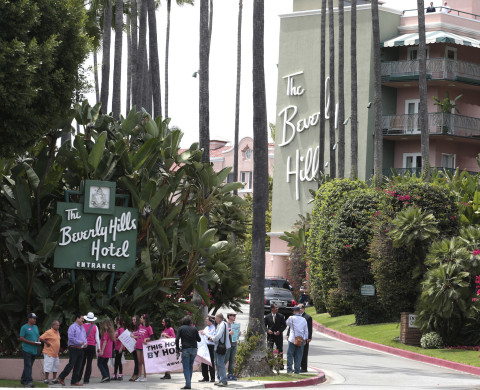People protest outside the Beverly Hills Hotel, which is owned by the Sultan of Brunei, over Brunei's strict sharia law penal code in Beverly Hills, California May 5, 2014. The sultanate of Brunei in April became the first East Asian country to introduce Islamic criminal law, the latest example of a deepening religious conservatism that has also taken root in parts of neighbouring Malaysia and Indonesia.