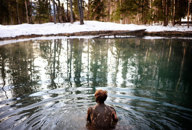 Joey Howell skinny dips in a hot spring near the Yukon border on March 15, 2014.  Howell and James Roh broke up the week-long drive north through Canada with a soak in the natural springs.  JAMES ROH