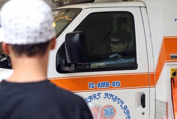 12/7/10 San Juan, Puerto Rico Funeral de Edgardo Velazquez Velazquez quien es velado sentado en una de las ambulancias de la compania que dirigen en el sector El Gandul en Trujillo Alto. (PRIMERA HORA/Teresa Canino Rivera)
