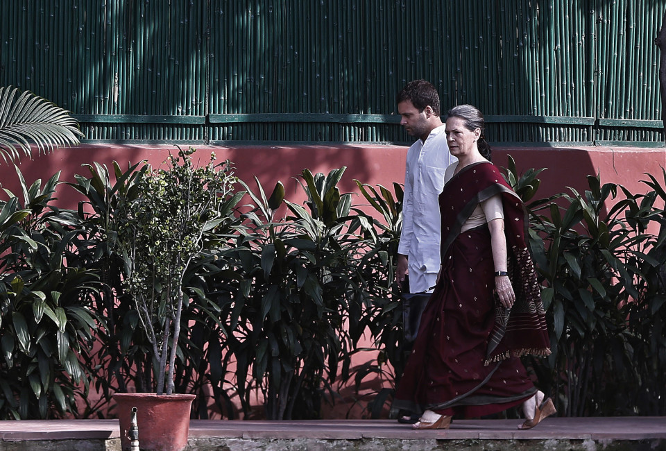 Congress party chief Sonia Gandhi (R) and her son and vice-president of Congress Rahul Gandhi arrive to attend the Congress Working Committee (CWC) meeting in New Delhi May 19, 2014. India's Congress party was preparing to rally around the Nehru-Gandhi dynasty on Monday to snuff out possible dissent after it suffered its most humiliating defeat in an election. Both party chief Sonia Gandhi and her son and heir apparent, Rahul, have accepted responsibility for the loss. Ahead of a top-level meeting, party sources said there was no question of either resigning their posts. REUTERS/Adnan Abidi (INDIA - Tags: POLITICS ELECTIONS) - RTR3PTR6
