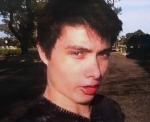 An undated photo of murder suspect Elliot Rodger is seen at a press conference by the Santa Barbara County Sheriff in Goleta, California May 24, 2014.  Rodger, 22, went on a rampage in Isla Vista near the University of California at Santa Barbara campus, stabbed three people to death at his apartment before shooting to death three more in a terrorizing crime spree through the neighborhood. AFP PHOTO / ROBYN BECK        (Photo credit should read ROBYN BECK/AFP/Getty Images)