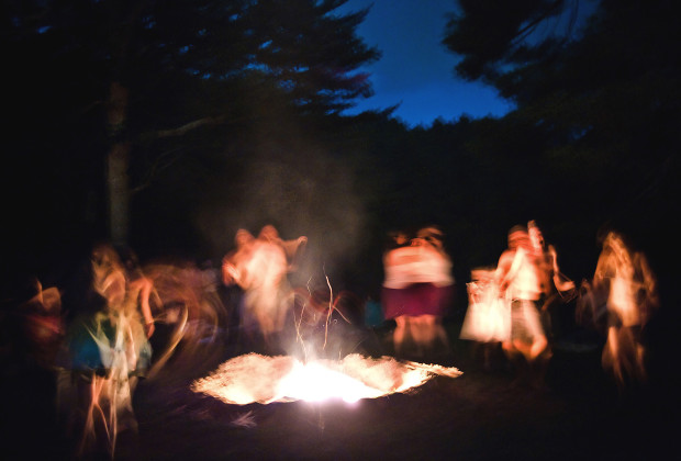 Dancers circle the fire during a drum circle on the opening night of Firefly 2011 near Asheville, North Carolina.