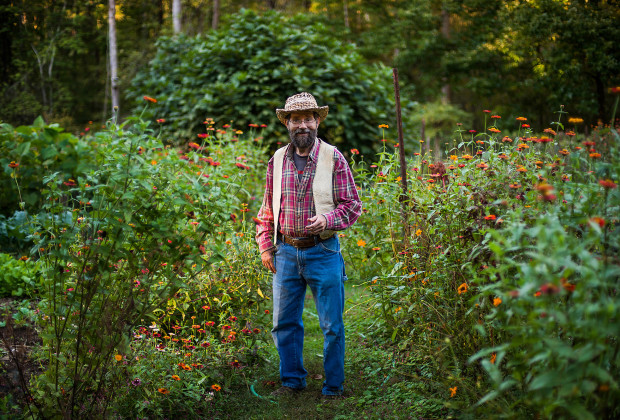 Doug Elliot, a teacher at Firefly Gathering poses for a portrait in his garden at his rural homestead in Rutherfordton, North Carolina. Doug is one of the most knowledgable naturalists in the country and is the author of several books ranging from plant identification to folk lore to children's stories.