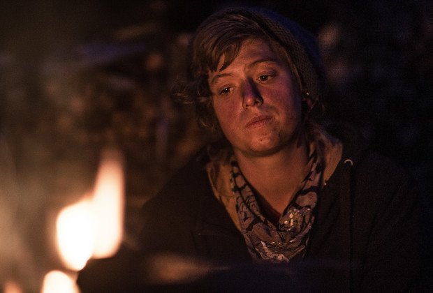 Rachel looks into the fire during dinner. Dinner is the most social time at Wildroots. It usually follows a long hard day of working on the land or cutting firewood, and songs and conversations around the fire are a nice way to end the day.