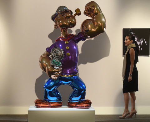 """Popeye"" by Jeff Koons and ""Six Self Portraits"" by Andy Warhol are on display during a preview of Sotheby's contemporary art evening sale in New York, May 2, 2014. Sotheby's is to hold it's contemporary art evening sale on May 14, 2014. AFP PHOTO/Emmanuel Dunand      ""MANDATORY MENTION OF THE ARTIST UPON PUBLICATION""        (Photo credit should read EMMANUEL DUNAND/AFP/Getty Images)"