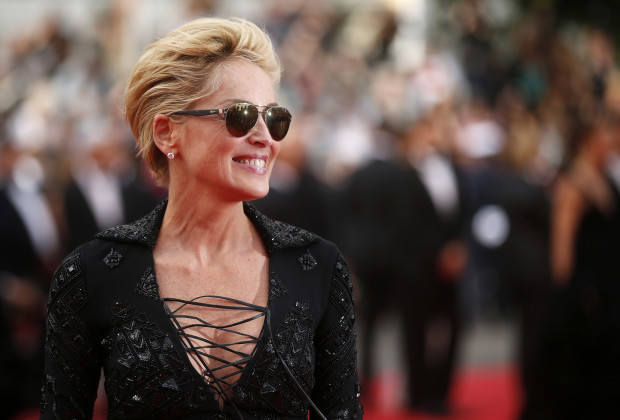 "Actress Sharon Stone poses on the red carpet as she arrives for the screening of the film ""The Search"" in competition at the Cannes Film Festival."