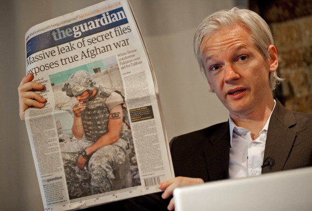 "Australian founder of whistleblowing website, 'WikiLeaks', Julian Assange holds up a copy of today's Guardian newspaper during a press conference in London on July 26, 2010. The founder of a website which published tens of thousands of leaked military files about the war in Afghanistan said Monday they showed that the ""course of the war needs to change"".  In all, some 92,000 documents dating back to 2004 were released by the whistleblowers' website Wikileaks to the New York Times, Britain's Guardian newspaper, and Germany's Der Spiegel news weekly.    Assange also used a press conference in London to dismiss the White House's furious reaction to the disclosures.    AFP PHOTO/Leon Neal (Photo credit should read LEON NEAL/AFP/Getty Images)"