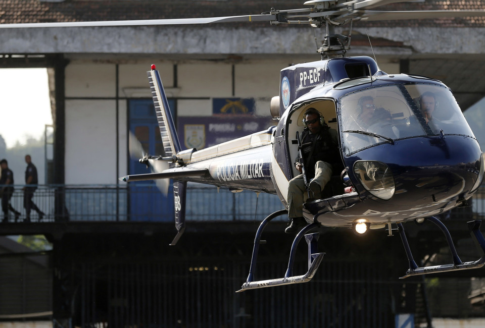 An helicopter takes up position during a crowd control training session, with FBI agents, for troops providing security for the 2014 World Cup, in Rio de Janeiro.