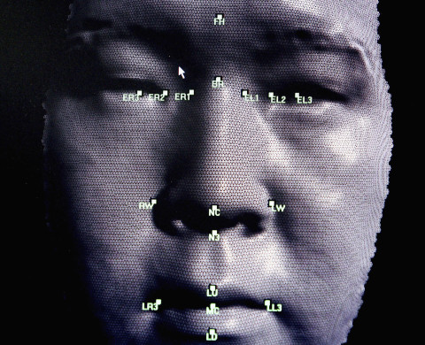 LONDON - OCTOBER 14: A 3D facial recognition program is demonstrated during the Biometrics 2004 exhibition and conference October 14, 2004 in London. The conference will examine the role of new technology such as facial recognition and retinal scans to determine identity to improve security. (Photo by Ian Waldie/Getty Images)     *** Local Caption ***