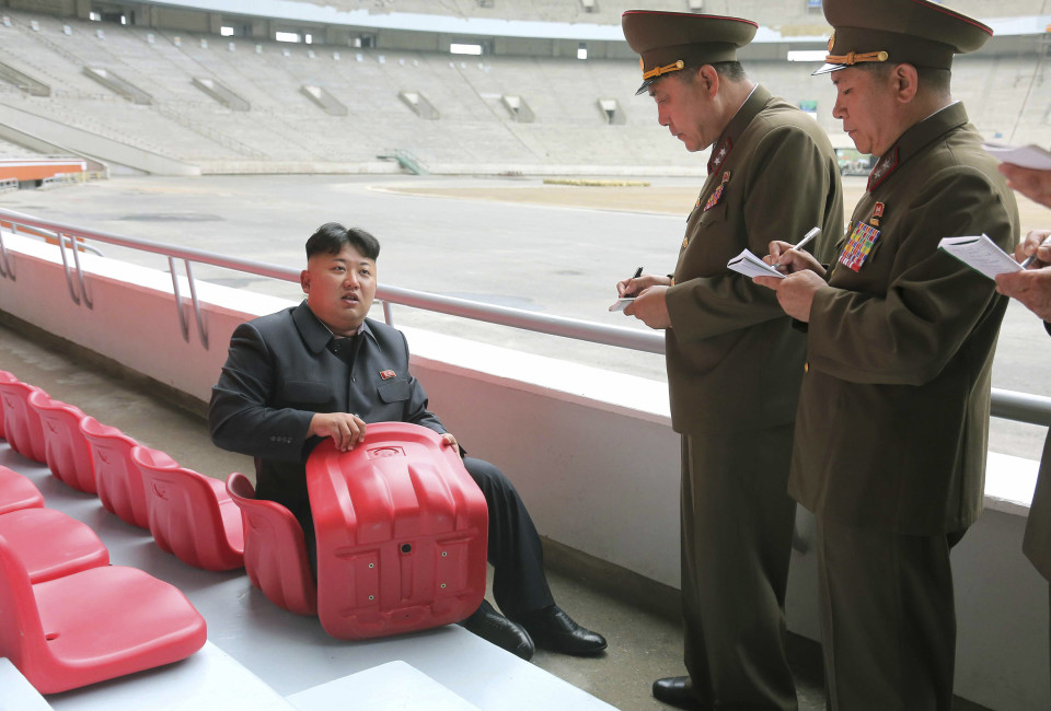 North Korean leader Kim Jong Un gives field guidance to the remodelling site of the May Day Stadium in this undated photo released by North Korea's Korean Central News Agency (KCNA) in Pyongyang June 20, 2014.