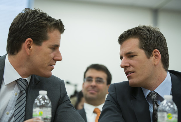 "Brothers Cameron (L) and Tyler Winklevoss talk to each other as they attend a New York State Department of Financial Services (DFS) virtual currency hearing in the Manhattan borough of New York January 28, 2014. New York will propose regulating virtual currency firms that operate in the state this year and may require them to obtain a ""BitLicense,"" state banking regulator Benjamin Lawsky said on Tuesday. REUTERS/Lucas Jackson (UNITED STATES - Tags: BUSINESS) - RTX17YO7"