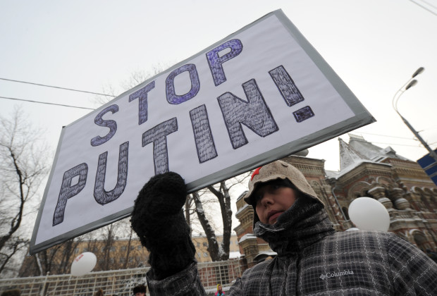 "A protester carries a makeshift poster in central Moscow, on February 4, 2012, during a rally to urge Putin to quit power ahead of March 4 polls in which he  is planning to reclaim his old Kremlin job. The poster reads: ""Everyone  to elections, not a single vote to Pu [(colloquial for Putin]!""  The rally by the anti-Putin movement, its third since disputed December 4 parliamentary polls, is seen as a crucial test of whether activists can keep their momentum to pose a real challenge to the Russian strongman. AFP PHOTO / KIRILL KUDRYAVTSEV (Photo credit should read KIRILL KUDRYAVTSEV/AFP/Getty Images)"