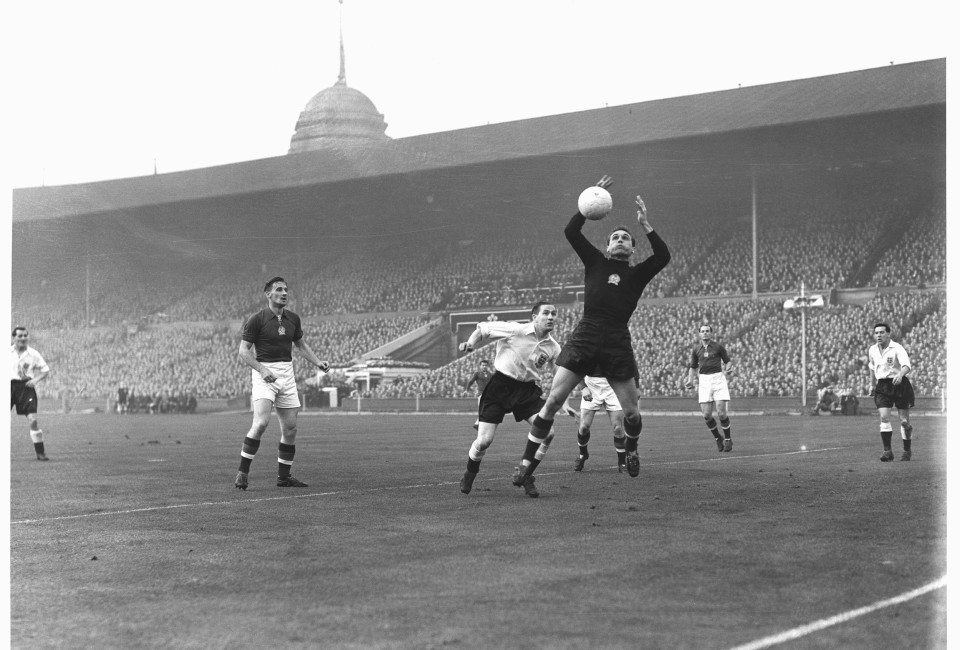 England V Hungary. Mortensen challenges the Hungarian goalkeeper, Grosics, during the international at Wembley, on November 25, 1953.