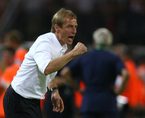 Germany coach Juergen Klinsmann gestures to his players during their World Cup 2006 semi-final soccer match against Italy in Dortmund July 4, 2006.