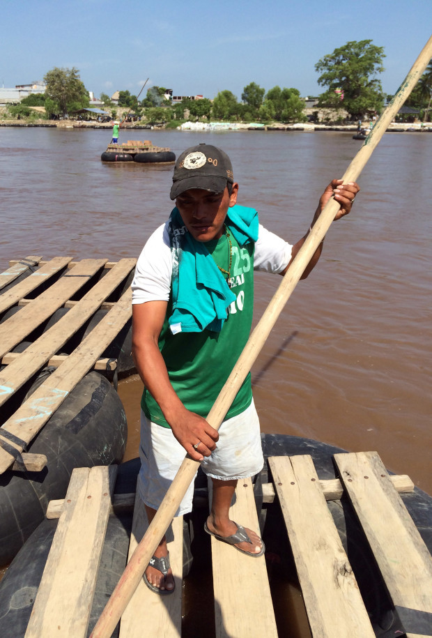 Raftsman Juan Carlos Marroquín crosses the river 20 times per day on average. He says he never checks his cargo or asks questions to his passengers.