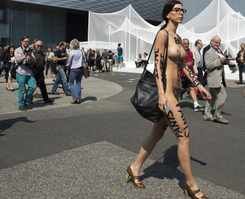epa04266245 Swiss performance artist Milo Moire walks naked as part of her performance 'The Script System' on the exhibition site of the international art fair Art Basel 2014, in Basel, Switzerland, 19 June 2014. The event runs from 19 to 22 June.  EPA/GEORGIOS KEFALAS