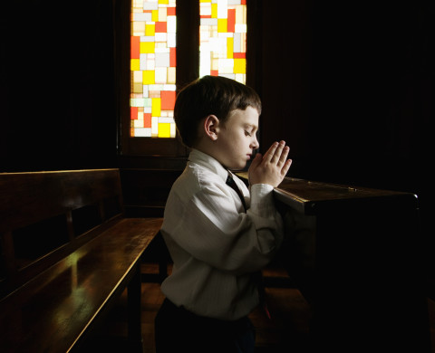 Boy Praying in Church