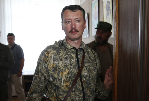 Pro-Russian separatist commander Igor Strelkov leaves after a news conference in the eastern Ukrainian city of Donetsk, July 10, 2014. Ukrainian forces regained more ground but sustained further casualties on Thursday in clashes with separatists, while two Western allies urged Russia's Vladimir Putin to exert more pressure on the rebels to find a negotiated end to the conflict.