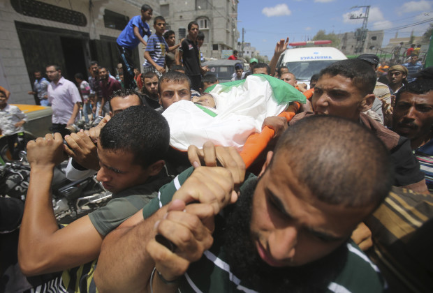 ATTENTION EDITORS - VISUAL COVERAGE OF SCENES OF INJURY OR DEATH  Palestinians carry the body of Hamas militant Basheer Abeda'll, who medics said was killed by an Israeli air strike which took place before a five-hour humanitarian truce, during his funeral in Rafah in the southern Gaza Strip July 17, 2014. Palestinians rushed to shops and banks on Thursday as the truce agreed by Israel and Hamas came into force, hours after the Israeli military said it had fought off gunmen who infiltrated from Gaza. Gaza health officials say at least 224 Palestinians, mostly civilians, have been killed. In Israel, one civilian has been killed by fire from Gaza, where the Israeli military says more than 1,300 rockets have been launched into the Jewish state. The temporary truce took effect on Thursday at 10 a.m. (0700 GMT).