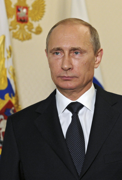 Russian President Vladimir Putin makes a televised statement at the Novo-Ogaryovo state residence outside Moscow, in the early hours of July 21, 2014. Putin said on Monday the downing of Malaysia Airlines Flight MH17 in east Ukraine must not be used for political ends and urged separatists to allow international experts access to the crash site.