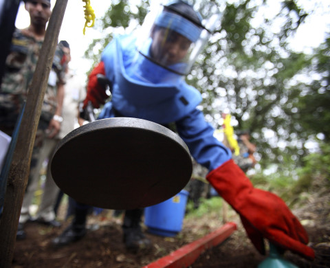 A Nepal Army personnel searches for landmines with a metal detector during a demonstration on to how to clear landmines at the top of the Phulchowki hill after the detonation of the last landmine field that was planted by the Nepal Army during the decade long armed conflict with the Maoist near Kathmandu June 14, 2011. With the explosion of the last remaining landmine in Phulchowki minefield Nepal became the second country in Asia to be declared free of landmine fields. The minefield in Phulchowki is one of the 53 locations thought the country where landmines were laid by the Nepal Army to protect militarys installation and physical infrastructure such as communication and hydropower stations. REUTERS/Navesh Chitrakar (NEPAL - Tags: POLITICS MILITARY) - RTR2NNGV