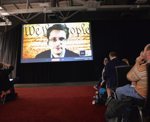 "AUSTIN, TX - MARCH 10:  NSA whistleblower Edward Snowden speaks via videoconference at the ""Virtual Conversation With Edward Snowden"" during the 2014 SXSW Music, Film + Interactive Festival at the Austin Convention Center on March 10, 2014 in Austin, Texas.  (Photo by Michael Buckner/Getty Images for SXSW)"