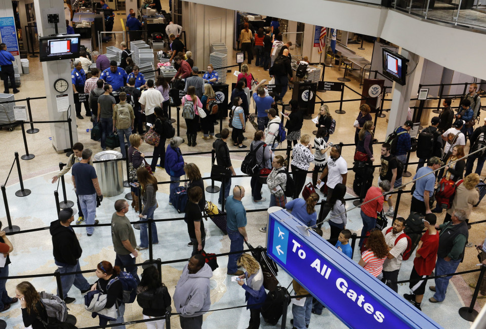 Passengers wait in a security line a day before the annual Thanksgiving Day holiday at the Salt Lake City international airport.
