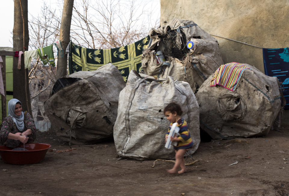 A Syrian mother washes laundry outside a tent her family has erected on a vacant lot in the Suleymaniye quarter of Istanbul. In the past few months, dozens of desperate Syrian families have moved into the Suleymaniye quarter after the municipality pushed the former residents to vacate them and then had them partially demolished. CREDIT: JODI HILTON