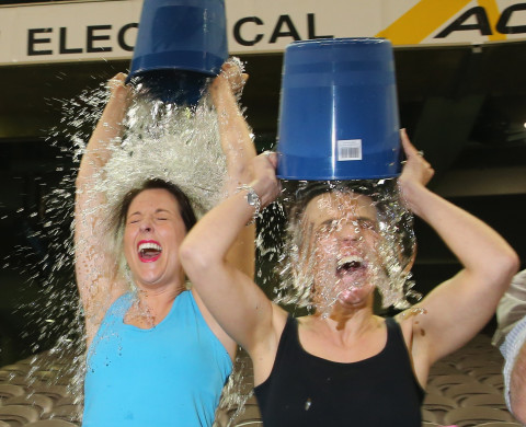 Participants sign up to take part in the World Record Ice Bucket Challenge at Etihad Stadium on August 22, 2014 in Melbourne, Australia.  The Ice Bucket Challenge is the social media phenomenon which is helping raise awareness and money for sufferers of Motor Neurone Disease.
