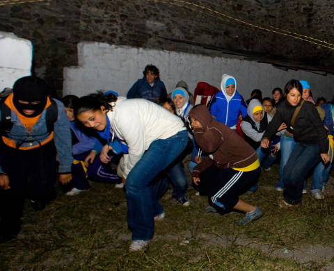 "Mexican students take part in a ""nigth walk"" (caminata nocturna in Spanish) at the ecopark Alberto, in El Alberto, state of Hidalgo, on October 4, 2008. The night walk, advertised as an extreme sport, fakes a border crossing -among dinghy rides and camping- at a park run by a community with a long-lasting history of carrying out real border journeys into the United States for its survival. AFP PHOTO/Luis Acosta (Photo credit should read LUIS ACOSTA/AFP/Getty Images)"