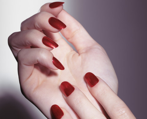Closeup of woman hands with shiny red nail polish and a red stone ring --- Image by © Oleksiy Maksymenko/ /age fotostock Spain S.L./Corbis