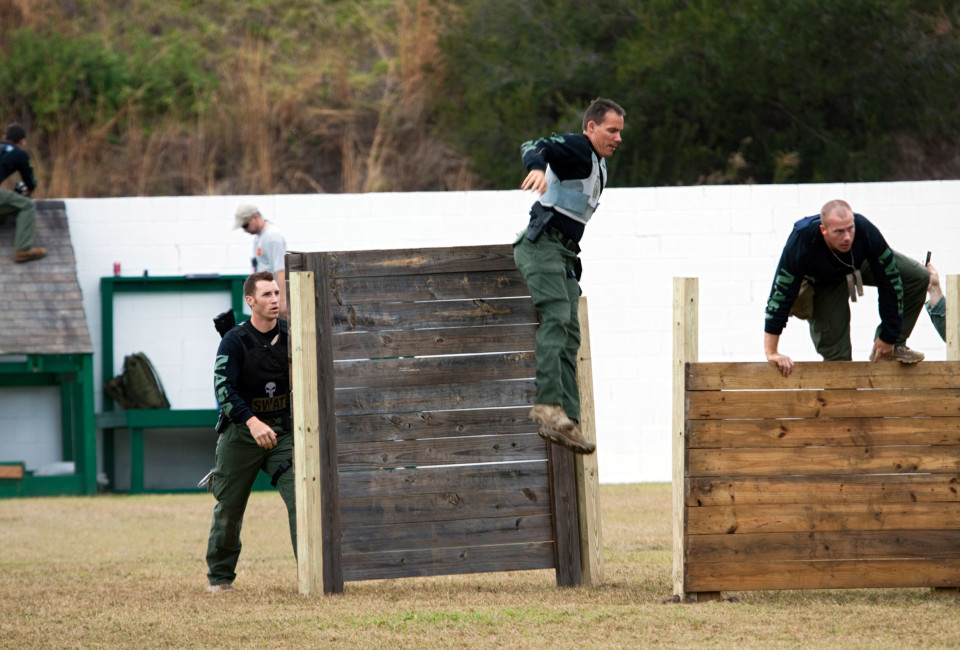 After climbing wall obstacles, Emergency Response Team members from Kennedy move to the next challenge during a SWAT Round-Up International event.