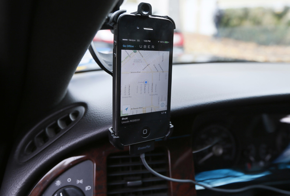 Transportation app Uber is seen on the iPhone of limousine driver Shuki Zanna, 49, in Beverly Hills, California, December 19, 2013. Uber has entered more than 60 markets, ranging from its hometown of San Francisco to Berlin to Tokyo. Leaked financials in December indicate that the company, which began connecting passengers with drivers of vehicles for hire about 3-1/2 years ago, is generating $200 million a year in revenue beyond what it pays to drivers. Photo taken December 19, 2013. REUTERS/Lucy Nicholson (UNITED STATES - Tags: BUSINESS TRANSPORT) - RTX1705F