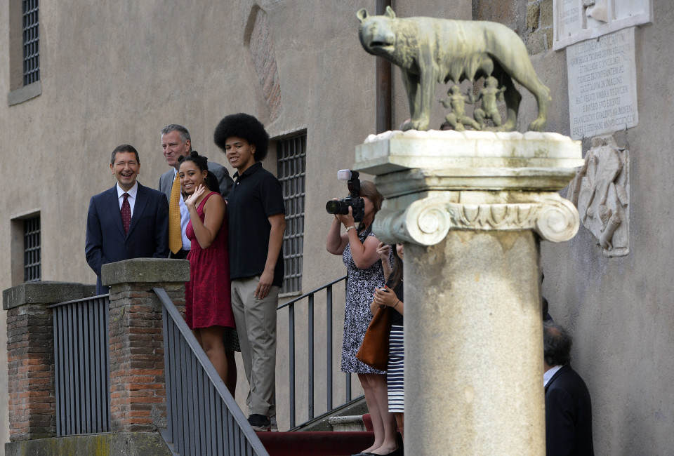 The mayor of Rome Ignazio Marino (L) poses with New York city mayor Bill de Blasio, his wife Chirlane McCray (hidden) and their children Dante and Chiara at the balcony of Rome's city hall before their meeting on July 20, 2014.