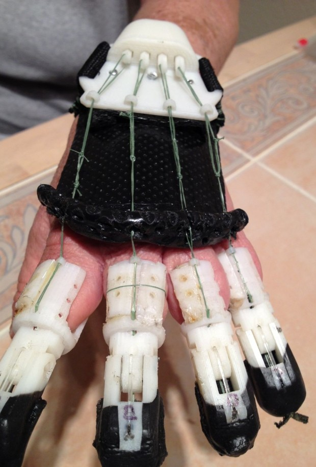 Howard Kamarata's prosthetic hand was created using a 3-D printer and attaching the fingers to a glove.