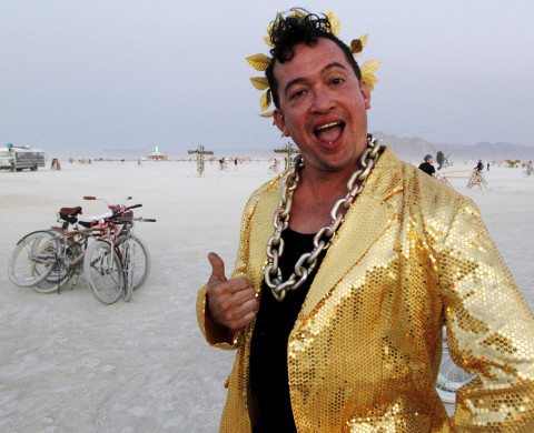 "Burning Man participant Fritz Gomez Wood gives a thumbs up during the ""Gold Bikini Happy Hour"" hosted by Rat Camp at the 2013 Burning Man arts and music festival in the Black Rock desert of Nevada, August 30, 2013.  The Burning Man organization received approval from the federal government to have a maximum of 68,000 participants attend the festival.  REUTERS/Jim Bourg (UNITED STATES - Tags: SOCIETY) FOR USE WITH BURNING MAN RELATED REPORTING ONLY. FOR EDITORIAL USE ONLY. NOT FOR SALE FOR MARKETING OR ADVERTISING CAMPAIGNS. NO THIRD PARTY SALES. NOT FOR USE BY REUTERS THIRD PARTY DISTRIBUTORS - RTX1328H"